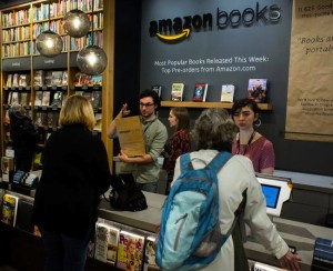 Customer pay for purchases at Amazon Books in Seattle, Washington, on Tuesday, Nov. 3, 2015. The online retailer Amazon.com Inc. opened its first brick-and-mortar location in Seattle's upscale University Village mall. Photographer: David Ryder/Bloomberg