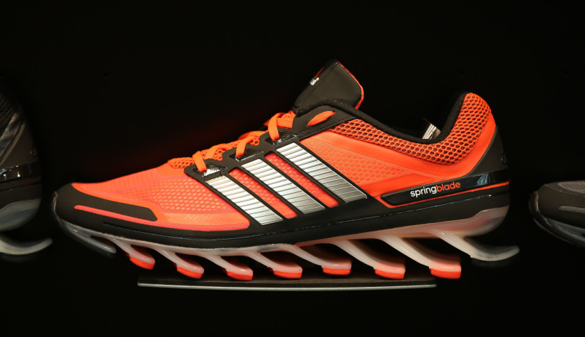 An Adidas Springblade running shoe sits on display inside the Adidas AG sportswear store in Moscow, Russia, on Friday, May 2, 2014. Adidas forecast 2014 profit as much as 17 percent below analysts' estimates as the weakness of currencies such as the Russian ruble and Argentine peso weighs on the world's second-biggest sporting-goods maker. Photographer: Andrey Rudakov/Bloomberg via Getty Images